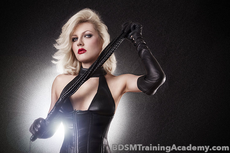 Dominatrix And Her Flogger