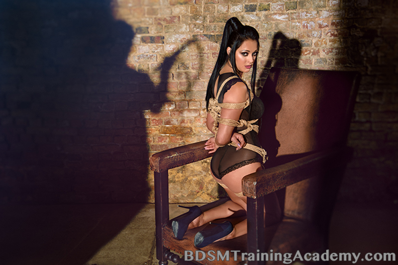 submissive in rope bondage waiting for dominant