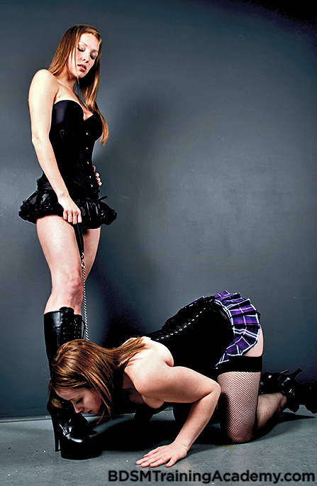 slave kissing dominatrix feet